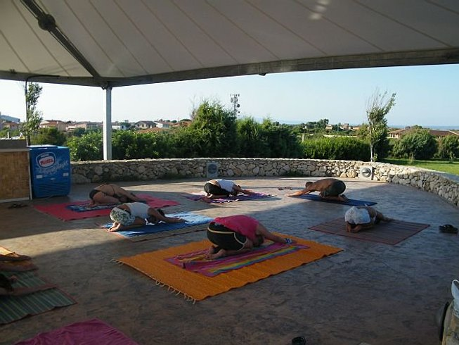 8 Days Exciting Yoga and Surf Camp in Oristano, Sardinia, Italy